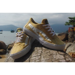 Social shoes made out of yellow tinted Burlap